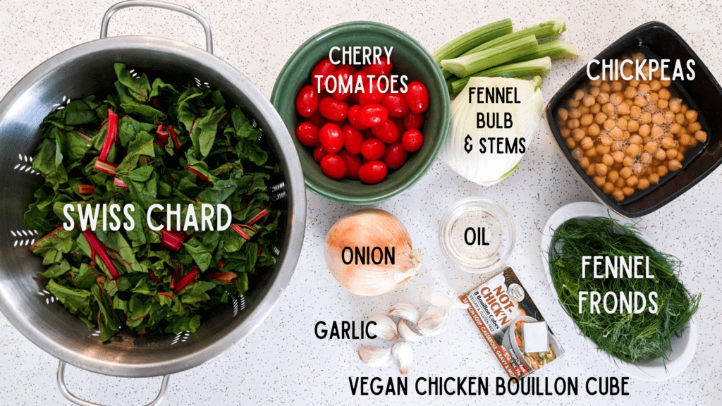 Overhead photo of ingredients with labels: Swiss chard, cherry tomatoes, onion, garlic, vegan chicken bouillon, oil, fennel, chickpeas