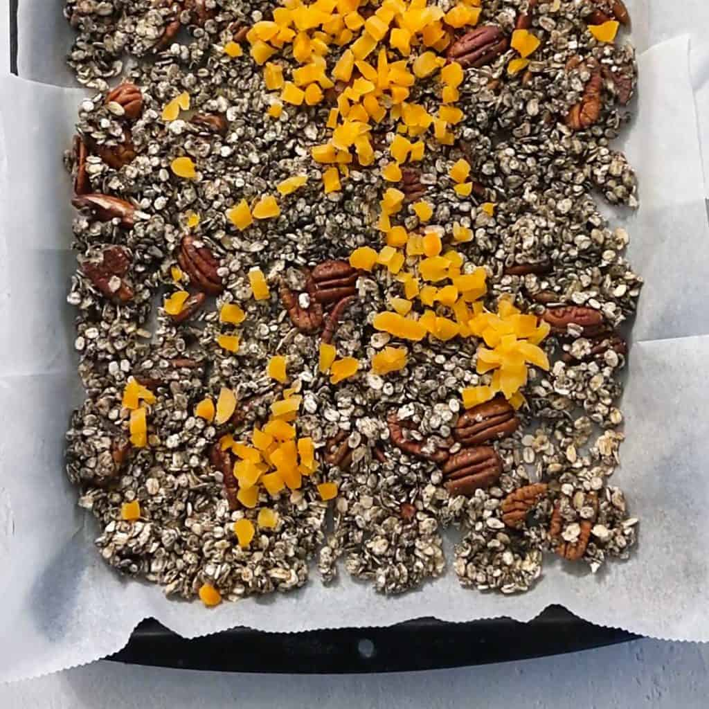 photo of adding apricots to granola after baking