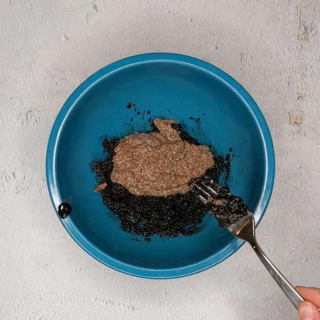Photo of adding flax egg to granola wet ingredients